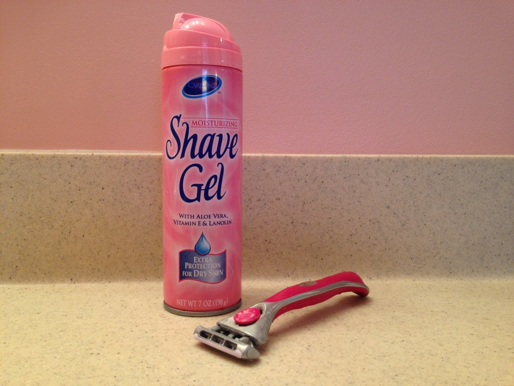 woman's razor and shave gel