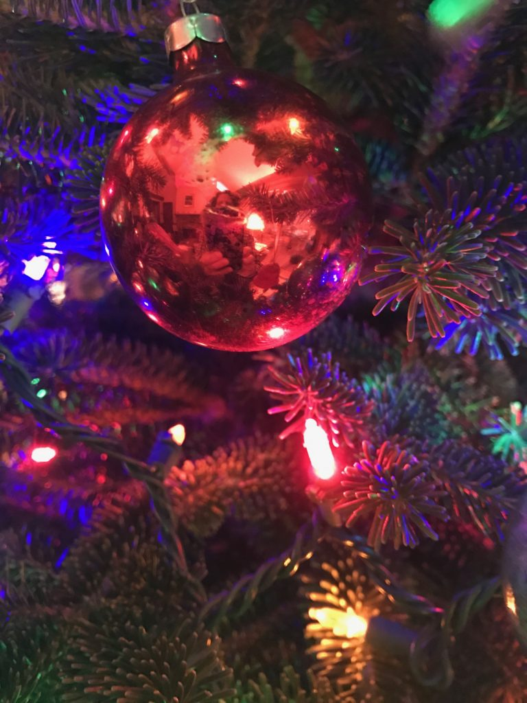 Christmas lights and red ornament