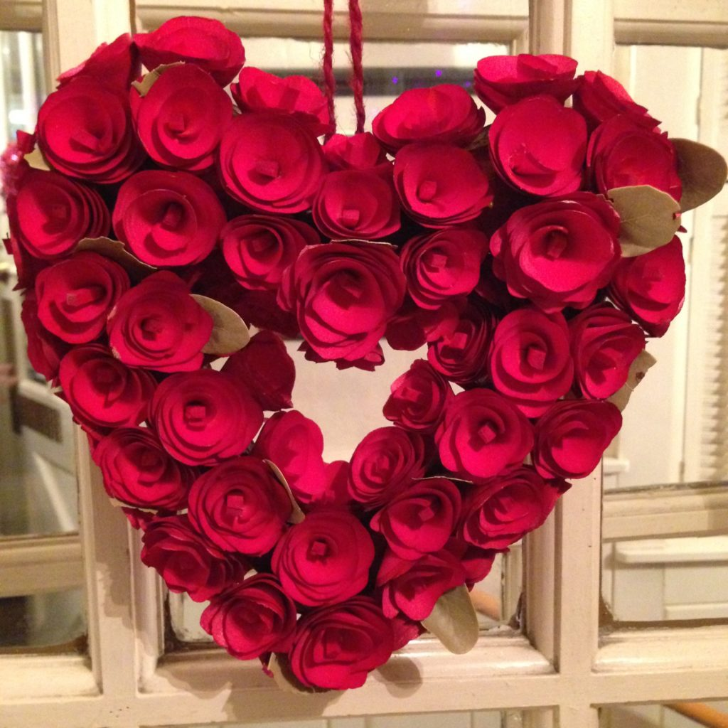 heart-shaped wreath of red flowers