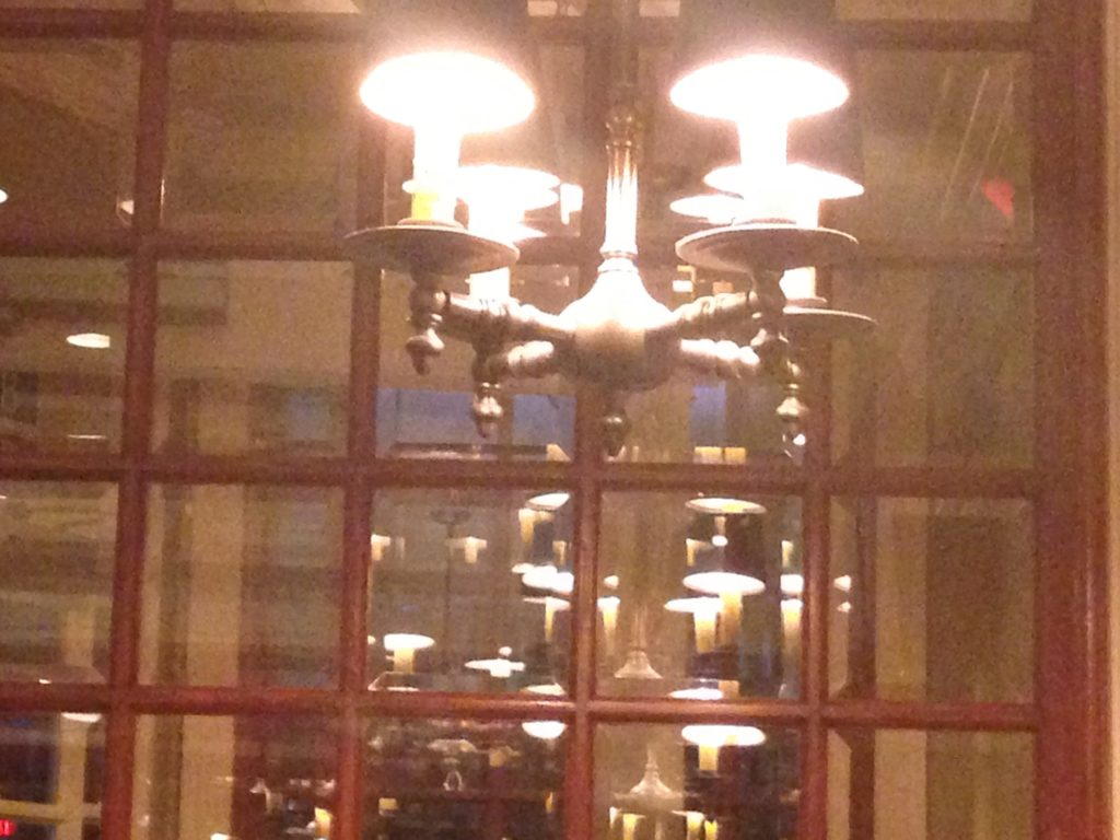casual chandelier reflected in window panes