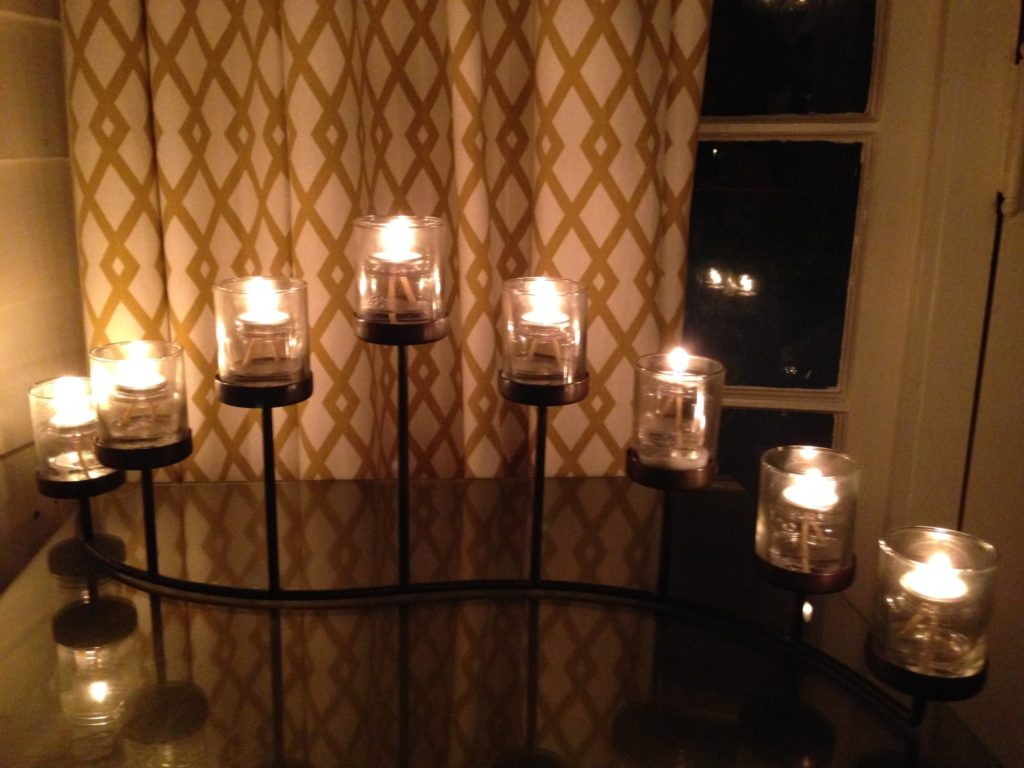 modern candle stand w lit candles