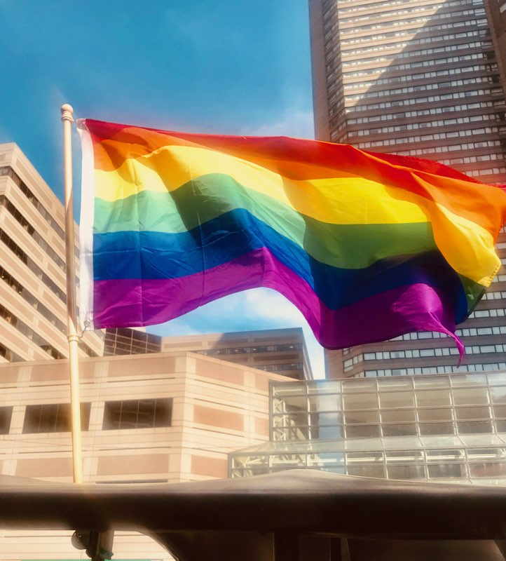 rainbow flag in urban setting