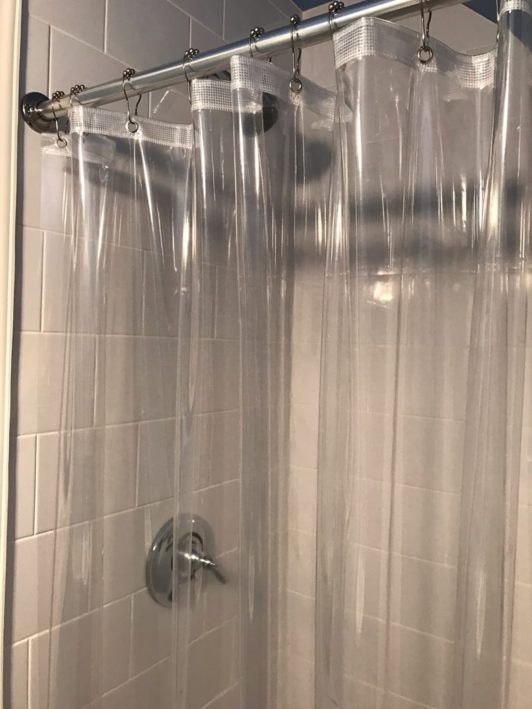 shower with clear shower curtain