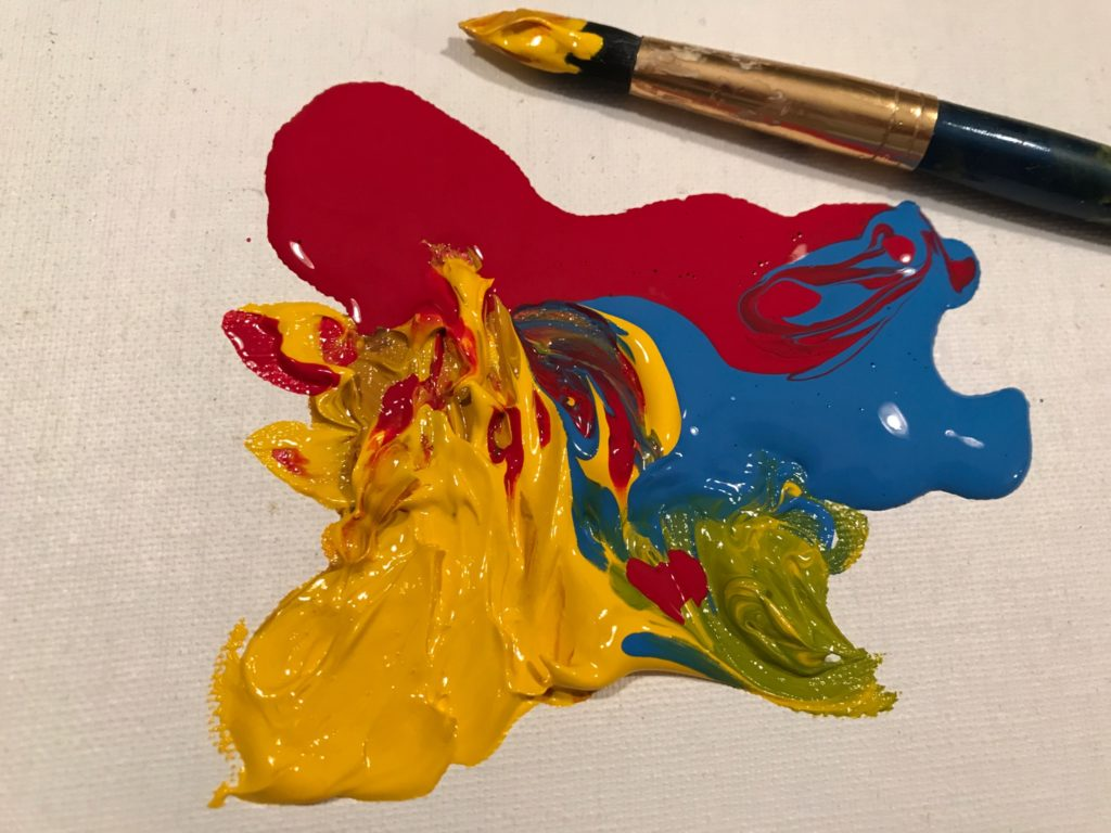 red, yellow and blue paint, swirled