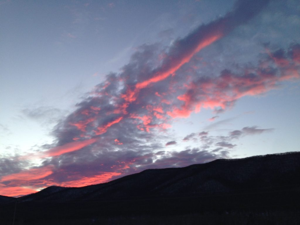 dramatic sunset with pink diagonal clouds