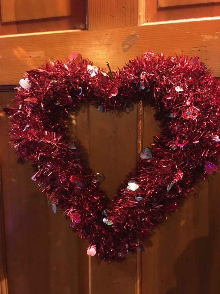 red, shimmery heart-shaped wreath