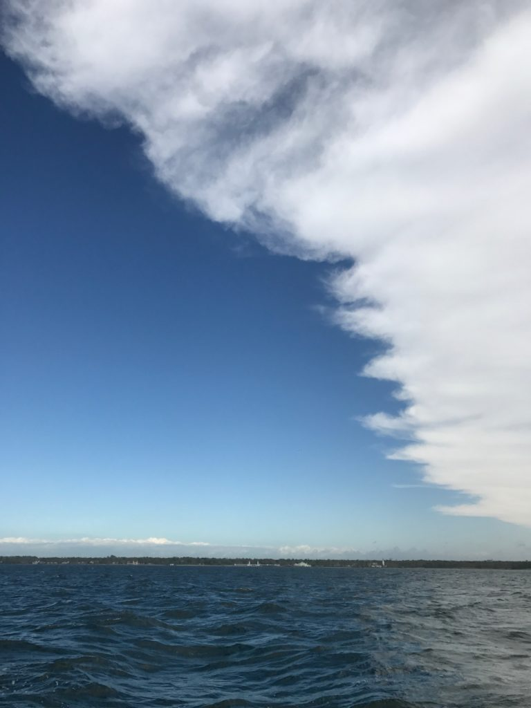 clouds giving way to clear sky
